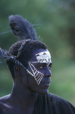 Young Massai Tribesman with traditional facial painting, Tanzania, Afrika