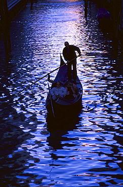 Couple on gondola, Venice, Italy