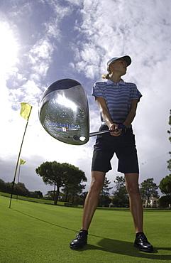 Woman playing Golf, Vale do Lobol, Mauritius
