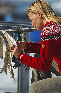 Woman with dried fish, Ilulissat, Greenland
