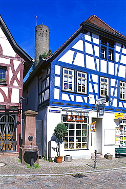 Half timbered houses and castle ruin under blue sky, Eppstein, Taunus, Hesse, Germany, Europe