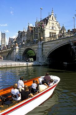 People in a boat and Graslei with St. Michiels bridge, Gent, Flanders, Belgium, Europe