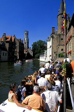 Rosenhoedkai, people on a boat in a canal, Bruges, Flanders, Belgium, Europe