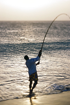 Man is fishing at the beach of S·o Pedro, S·o Vicente, Cape Verde, Africa
