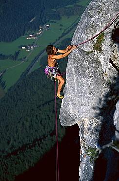 A man freeclimbing at a rock face, Loferer Alp, Salzburger Land, Austria, Europe