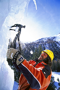 Man with ice axe in front of an ice face, Sand in Taufers, South Tyrol, Italy, Europe