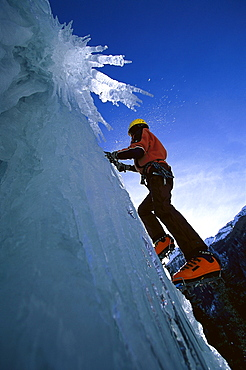 A man climbing over ice, Sand in Taufers, South Tyrol, Italy