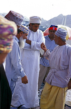 Men discussing at the harbour, Muscat, Oman, Middle East, Asia