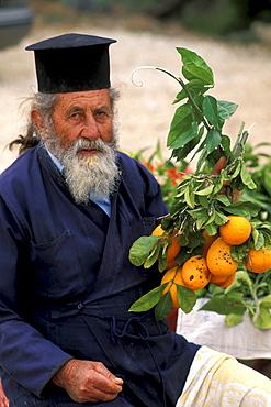 Orthodox priest selling oranges, Akamas, Cyprus