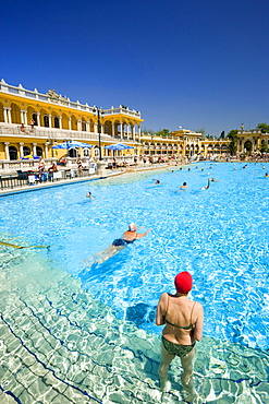 People swimming in open-air pool of Szechenyi-Baths, Pest, Budapest, Hungary
