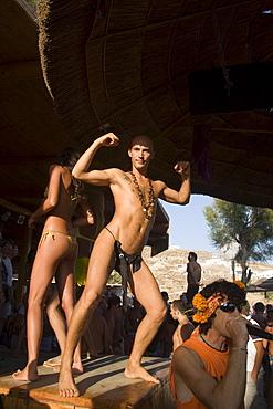 Man wearing a crazy thong in the Tropicana Club, Paradise Beach, Mykonos, Greece