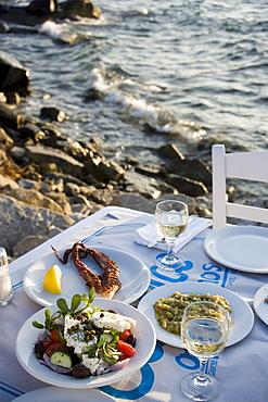Different greek starters, including salat, served in the Sea Satin Market Restaurant, Mykonos-Town, Mykonos, Greece