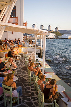 People sitting in restaurant directly at sea, Little Venice, Mykonos-Town, Mykonos, Greece