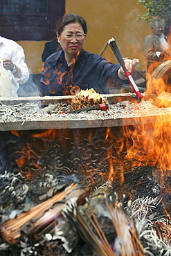 Longhua Temple, Longhua Temple and pagoda, oldest and largest buddhist temple in Shanghai, burning joss sticks, incense
