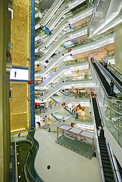 Shopping Shanghai, New World, Yao Han, shopping mall, escalator, shops, stores, mega malls, multi storey, advertising, consumers, fashion, design, atrium