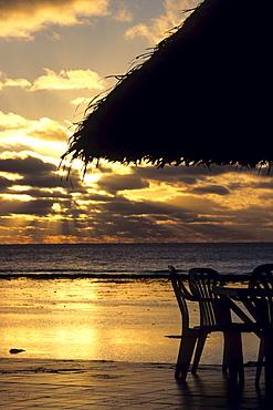 Deck Chair and Umbrella Sunset Silhouette, The Edgewater Resort, Rarotonga, Cook Islands