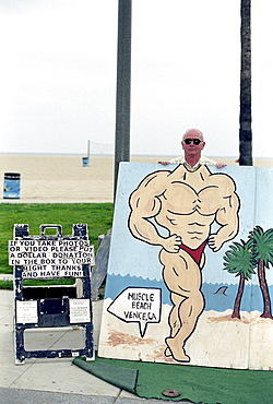 Man making pictures with bodybuilder dummy, Venice Beach, Los Angeles, California, USA