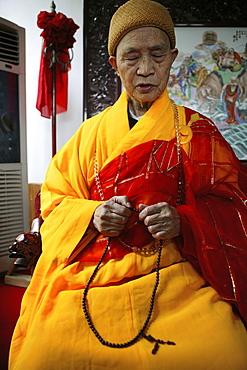 Praying abbot of Baotan Si monastery with prayer beads, Nantai, Heng Shan South, Hunan province, China, Asia