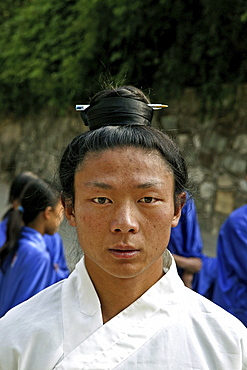 Taichi teacher with hair pinned up with a pen, Wudang School of Martial Arts, Purple Cloud Temple, Zi Xiao Gong, Mount Wudang, Wudang Shan, Taoist mountain, Hubei province, Wudangshan, Mount Wudang, UNESCO world cultural heritage site, birthplace of Tai chi, China