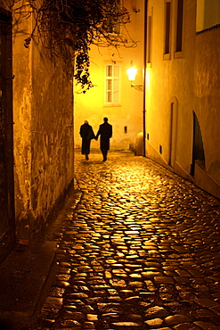 Couple walking down an alley, Mala Strana, Little Quarter, Prague, Czech Republic