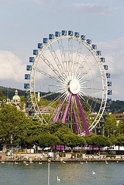 View over Lake Zurich to Ferris Wheel at Uto Quai, Zurich, Canton Zurich, Switzerland