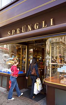 Two women entering the shop Spruengli (famous chocolate confectionery), Bahnhof Strasse, Zurich, Canton Zurich, Switzerland