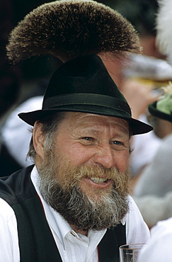 Man in traditional dress wearing hat with tuft of chamois hair, maypole festival in Flintsbach, Upper Bavaria, Bavaria, Germany
