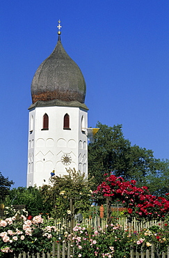 Clock tower of nunnery and nunnery garden with roses, island of Fraueninsel, Lake Chiemsee, Chiemgau, Upper Bavaria, Bavaria, Germany