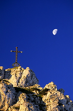 Summit of Kampenwand with cross and moon, Chiemgau range, Chiemgau, Bavarian range, Upper Bavaria, Bavaria, Germany