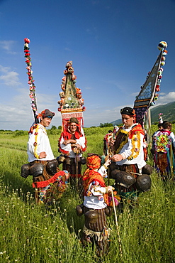 People in traditional costumes in a meadow, Rose Festival, Karlovo, Bulgaria, Europe