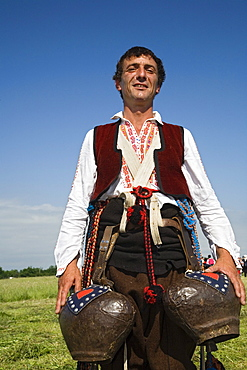 Man in traditional costume with bells, Rose Festival, Karlovo, Bulgaria, Europe
