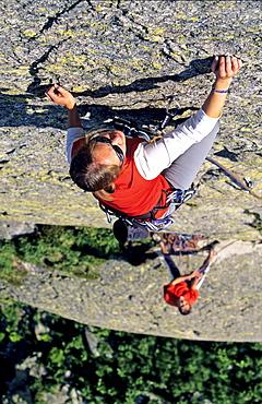 Young woman freeclimbing at rock, Bernese Oberland, Canton Uri, Switzerland, MR