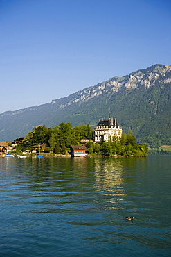 View over Lake Brienz to castle Seeburg, Iseltwald, Bernese Oberland (highlands), Canton of Bern, Switzerland