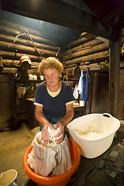 Anna Gruber kneading the cheese, traditional cheese production, Karseggalm (1603 m, one of the oldest mountain hut in the valley), Grossarl Valley, Salzburg, Austria