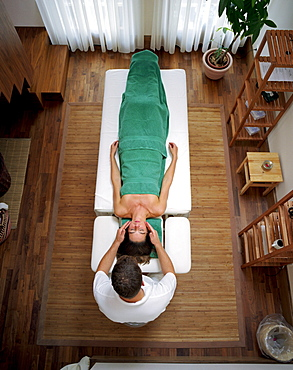 Woman having an Ayurvedic head massage, Spa area, Spa Hotel Seehotel Neuklostersee, Mecklenburg Western Pomerania, Germany