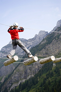 Boy in Central Switzerland's largest rope park, Fraegmuentegg, Lucerne, Canton of Lucerne, Switzerland