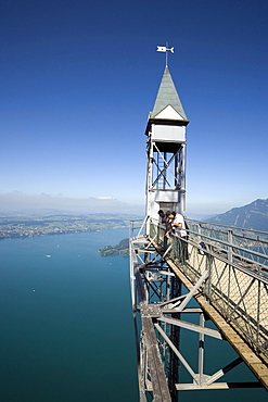 People standing on platform of Hammetschwand Elevator (153 m, highest exterior elevator of Europe) and looking down, Buergenstock (1128 m), Buergenstock, Canton Nidwalden, Switzerland