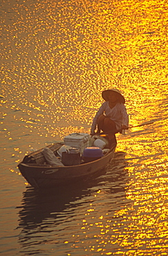 Fishing boat at sunset, rivers delta, Nha Thrang, Vietnam