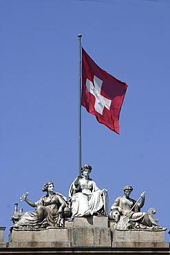 Switzerland, Zuerich, main station, sculptures on roof top with swiss flag
