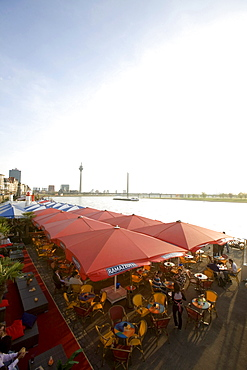 riverside walk, gastronomy at the promenade of Duesseldorf, old part of town, state capital of NRW, North-Rhine-Westphalia, Germany