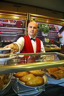 waiter in Cafe, red waistcoat, Valencia, Spanien