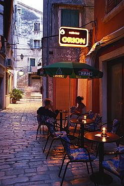 A couple sitting outside a street cafe in Roviny, Istria, Croatia