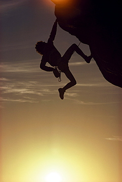 Silhouette of a man free climbing at Mount Arapiles at sunset, Rock Face, Sport, Victoria, Australia