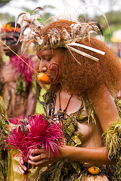 Young woman wearing traditional costume and headdress at Singsing Dance, Lae, Papue New Guinea, Oceania
