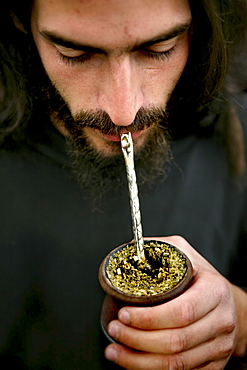 Argentinian man drinking mate, Argentinia, South America
