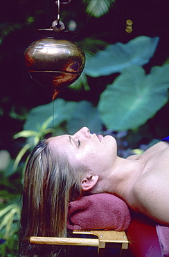 Woman relaxing in the spa, Spa of Peace and Plenty in Dunk Island Resort, Dunk Island, Great Barrier Reef, Australia