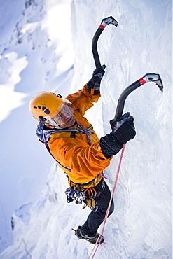 A man ice climbing on on a frozen waterfall, Corn Diavolezza near Pontresina, Grisons, Switzerland