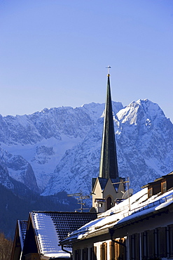 Spire of parish church Maria Himmelfahrt in front of the Zugspitze (2962 m), Garmisch-Partenkirchen, Upper Bavaria, Germany