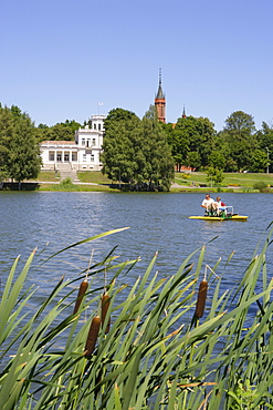 Boatride on Lake Druskonis. In the back: Druskininkais cultural center and the church of St. Mary, Lithuania