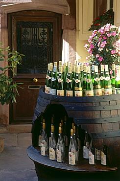 Wine bottles in a barrel, Wine growing town of Ribeauville, Alsace, Haut-Rhin, France